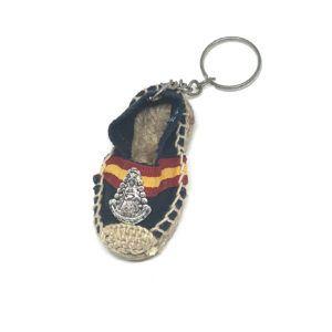 Llavero zapatilla de tela Virgen del Rocío. Color azul oscuro con bandera de España.