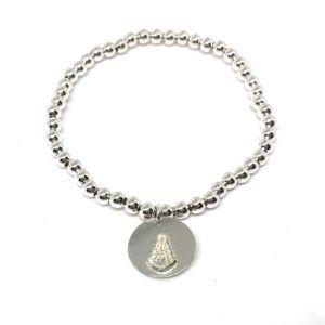 Pulsera elaborada con bolas pequeñas y medalla redonda de la Virgen del Rocío fabricadas en Plata de 1ª Ley.