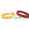 Pack 3 pulseras silicona de la Virgen del Rocío, en colores: Naranja, Blanco, Rojo.